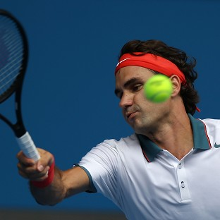 Roger Federer, pictured, will play Jo-Wilfried Tsonga in the fourth round of the Australian Open (AP)
