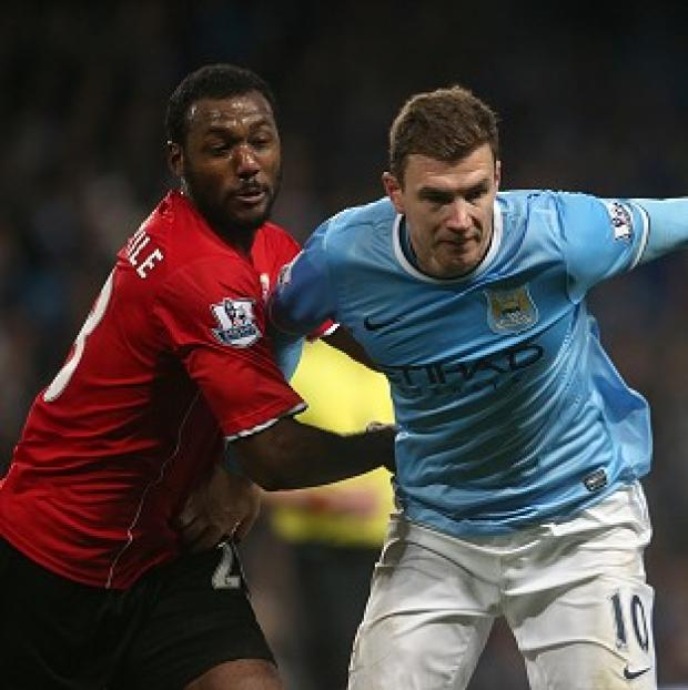 Andover Advertiser: Edin Dzeko, right, wants to win trophies at Manchester City