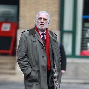 Andover Advertiser: DJ Dave Lee Travis arrives at Southwark Crown Court in London where he is accused of a series of indecent assaults and one sexual assault.