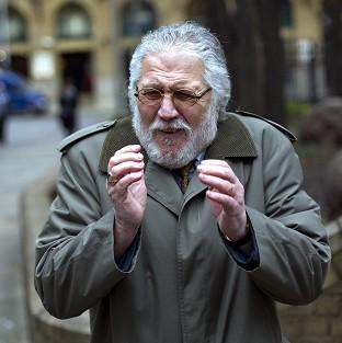 Former DJ Dave Lee Travis arrives at Southwark Crown Court in London, where he is accused of a series of indecent assaults and o