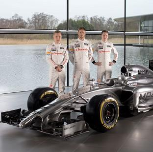 Jenson Button, centre, has a new team-mate at McLaren in the form of Kevin Magnussen