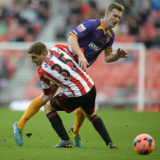 Sunderland's Charis Mavrias, left, scored the only goal of the game