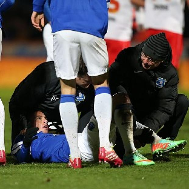 Andover Advertiser: Bryan Oviedo lies injured after the tackle