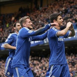 Oscar, right, celebrates scoring the only goal of the game