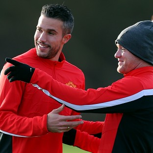 Robin van Persie, left, and Wayne Rooney both trained on Monday