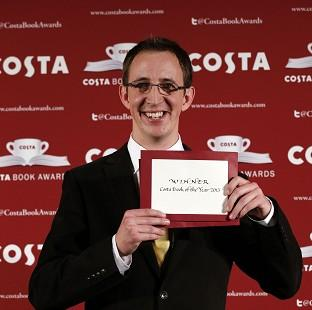 Nathan Filer accepts the 2014 Costa Book Award for his novel 'The Shock of the Fall' at Quaglino's, London.