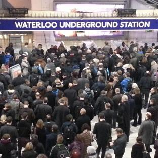 Andover Advertiser: Commuters queue at the entrance to the London Underground at Waterloo station during the strike