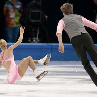 Stacey Kemp falls as she and David King of Britain compete in the figure skating team event (AP)