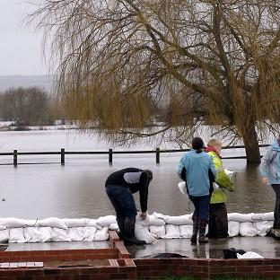 Andover Advertiser: Northmoor residents build a wall from sandbags to protect their community from the flooding on the Somerset Levels