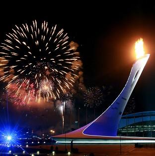 The Olympic Flame is lit in the Olympic Plaza during the opening ceremon