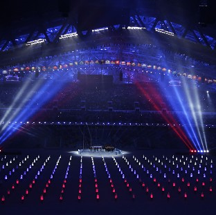 Performers wearing illuminated suits form the Russian flag during the Winter Olympics opening ceremony in Sochi