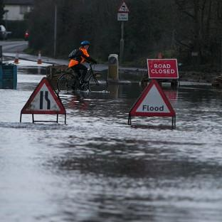 Andover Advertiser: A flooded road near Chertsey in Surrey as large swathes of England and Wales are on flood alert
