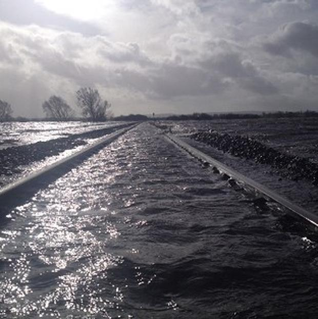 Andover Advertiser: The line at Bridgwater, Somerset, was under water after the River Perrett flooded on the Somerset Levels (Network Rail)