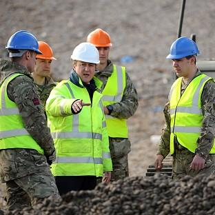 Andover Advertiser: Prime Minister David Cameron meets members of 39 Engineers as he inspects work being carried out on Chesil Beach between Portland and Weymouth in Dorset.
