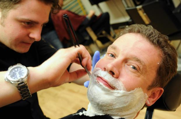 Business editor Richard Garfield enjoys a cut-throat shave from Luke Ruffell, of Taylor Made Men's Grooming