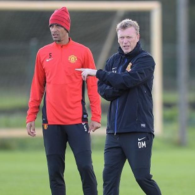 Andover Advertiser: Manchester United manager David Moyes, right, has hit out at speculation surrounding the future of Rio Ferdinand, left.