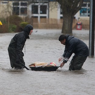 Man dies as storms batter Britain