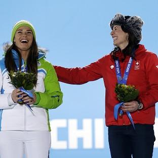 Dominique Gisin, right, and Tina Maze receive their medals (AP)