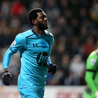 Adebayor at the double in rout