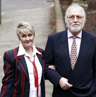 Andover Advertiser: Former disc jockey Dave Lee Travis arrives at Southwark Crown Court with his wife Marianne.