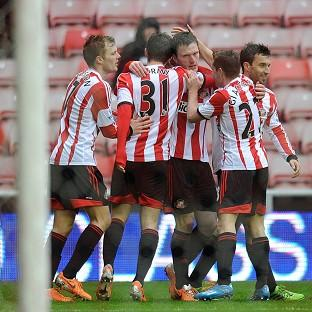 Craig Gardner, centre, is congratulated by his Sunderland team-mates after scoring
