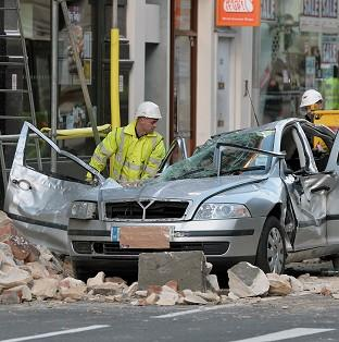 Andover Advertiser: Workmen clear debris at the scene in central London.