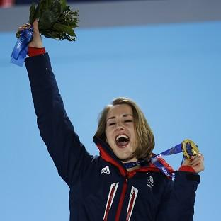Andover Advertiser: Lizzy Yarnold celebrates during the medals ceremony at the Winter Olympics (AP)