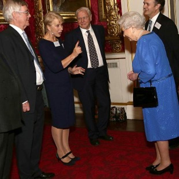 Andover Advertiser: Queen Elizabeth II (right) meeting Dame Helen Mirren, as Sir David Attenborough (third left) looks on, during a Reception for the Dramatic Arts, at Buckingham Palace, London.