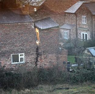 A view of a large crack on a house in Magdalen's Close, Ripon, after a 25ft wide sinkhole opened up in the street