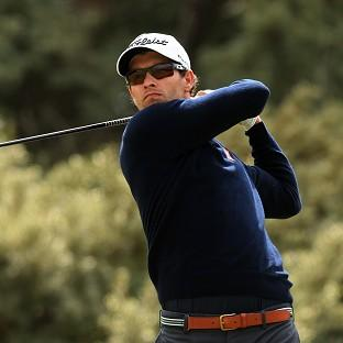 Adam Scott will defend his US Masters title at Augusta in April