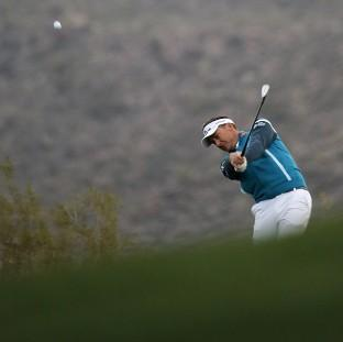 Ian Poulter trails Rickie Fowler by three holes (AP)