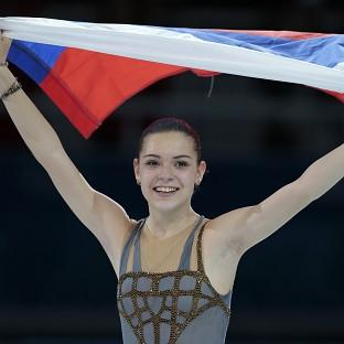 Adelina Sotnikova celebrates winning the ladies' figure skating (AP)