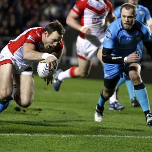 James Roby crosses over for one of his tries