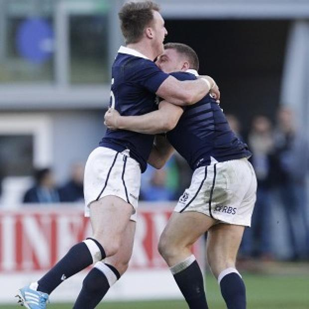 Andover Advertiser: Duncan Weir, right, and Stuart Hogg celebrate after the match-winning drop goal (AP)