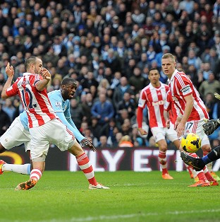 Yaya Toure scores the only goal of the game to secure victory for Manchester City