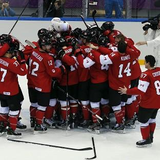Andover Advertiser: Canada celebrate winning gold (AP)