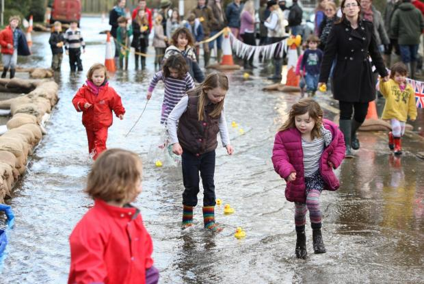 Andover Advertiser: The Bramdean duck race along the flooded A272