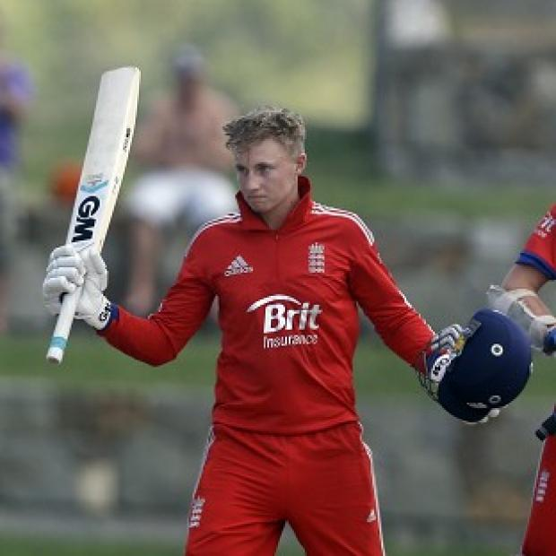Andover Advertiser: England's Joe Root, left, scored a century