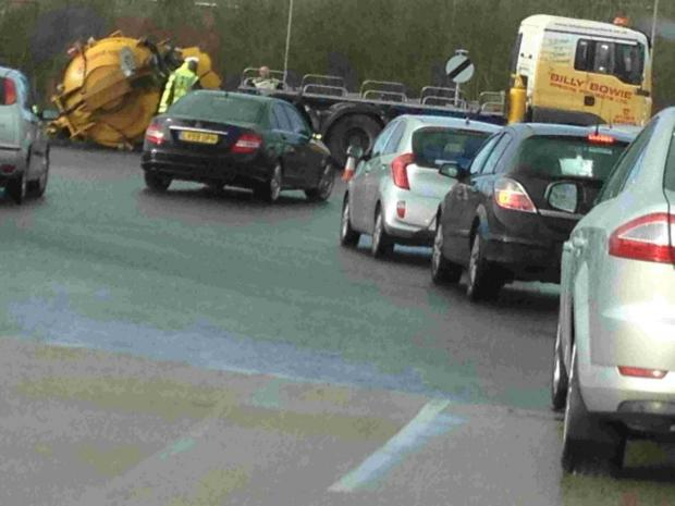Tailbacks after lorry loses its load