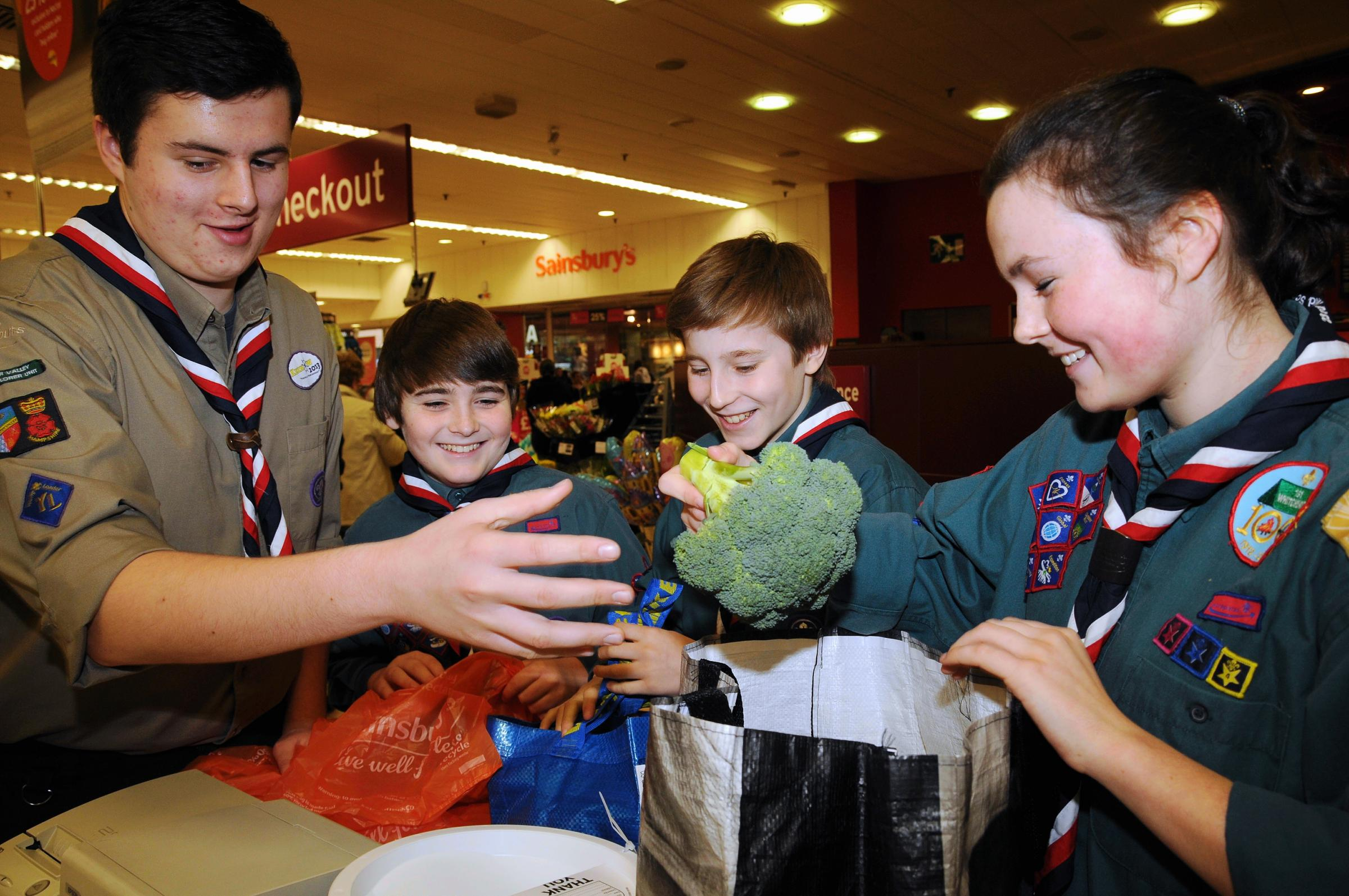 Scouts help to pack shopping at Sainsbury's in Basingstoke.