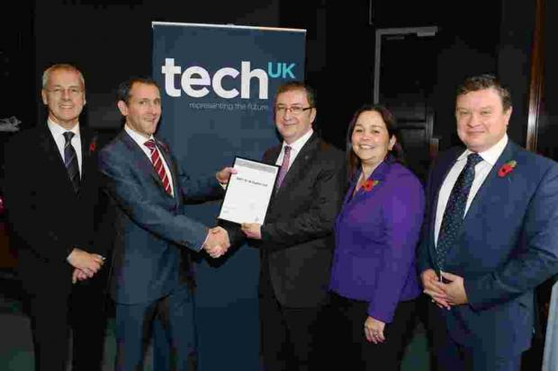 Simon Gould, managing director of BMT Hi-Q Sigma, receives the techUK Business Professional Certificate