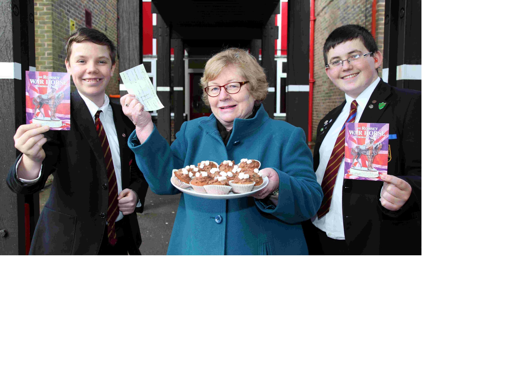 Dorothy Baverstock with Matthew Wakeham, 12, and Sam Egerton-Kemp, 15, from Romsey School, who raised money for the Romsey War Horse project with a cake sale
