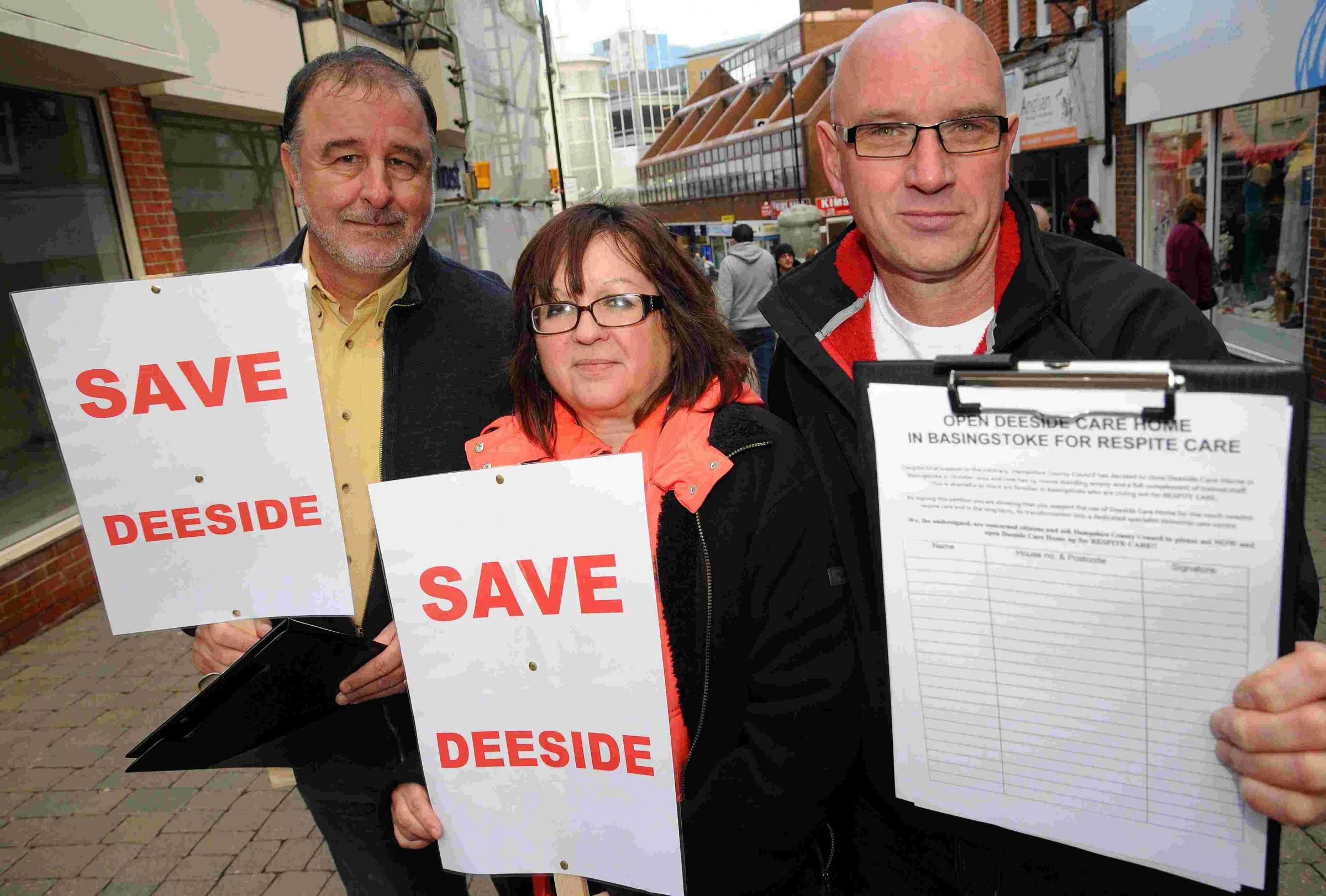 Campaigners Terry Tuxford, Lynn Rich and Peter Rich gather signatures