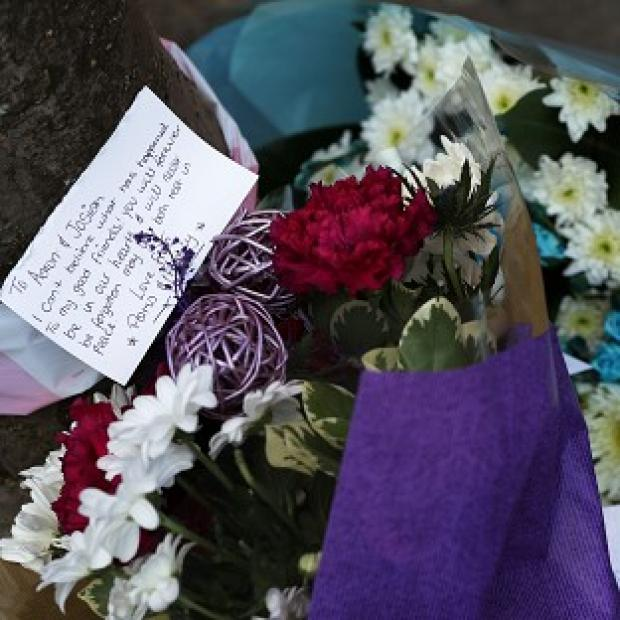 Andover Advertiser: Flowers laid at the site of the double murder in Leytonstone