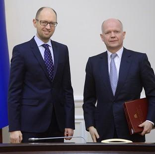 Andover Advertiser: Ukrainian Prime Minister Arseniy Yatsenyuk, left, and British Foreign Secretary William Hague