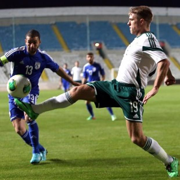 Andover Advertiser: Cyprus' Konstantinos Makridis, left, and northern Ireland's Jamie Ward battle for the ball (AP)