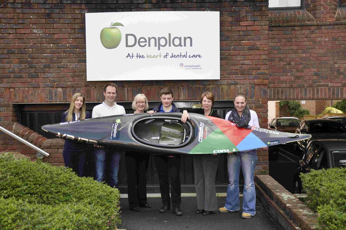 Noah Hazlewood (centre) receiving his new Kayak from Denplan. The teenager hopes to represent Great Britain.
