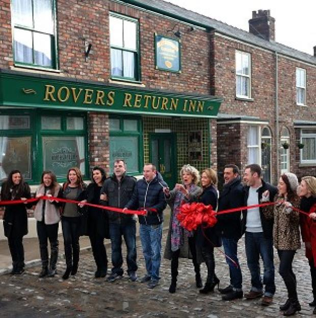 Andover Advertiser: Coronation Street cast members on the new set, including the famous cobbles