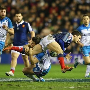 Scotland's Max Evans tackles France's Brice Dulin at Murrayfield