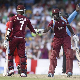Marlon Samuels, left, and Andre Russell celebrate their 50-run partnership (AP)